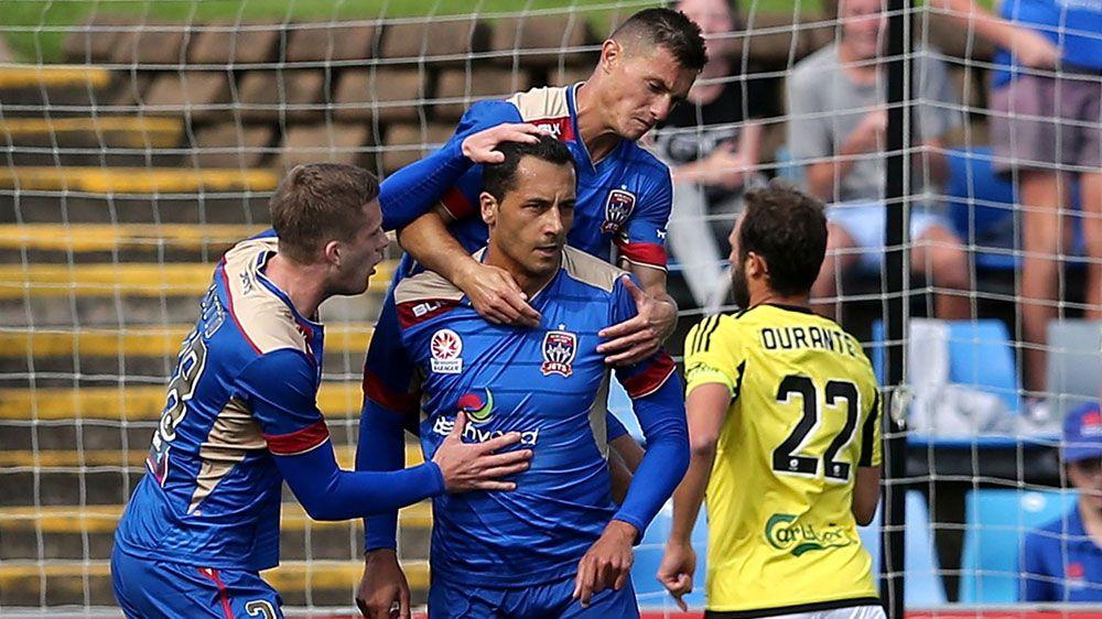 Newcastle team mates celebrate with Milos Trifunovic (AAP)