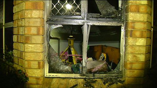 A child and pregnant woman who were sleeping inside the home at the time escaped unharmed. (9NEWS)