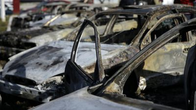Burnt cars are seen on West Florissant Avenue in Ferguson, Missouri after violent protests in the city. (AAP)
