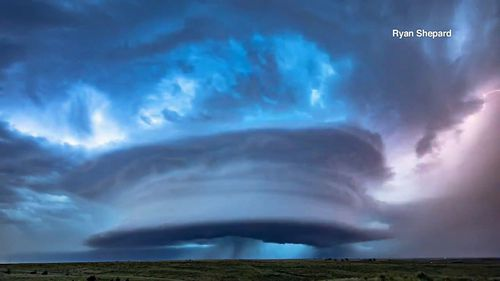 A massive supercell  was photographed hovering over Kansas cornfields.