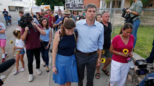 Former El Paso congressman Beto O'Rourke walks with his wife Amy and his successor Rep. Veronica Escobar during a vigil after the massacre in the Texas city.