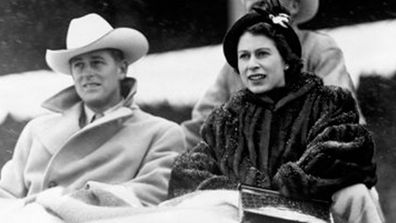 Princess Elizabeth and the Duke of Edinburgh watch a 'stampede' rodeo staged especially for them in Calgary, Alberta, during their tour of Canada. October 1951