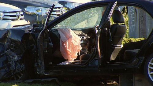 The Mazda veered off the road and crash into display cars at a car dealership (9NEWS)