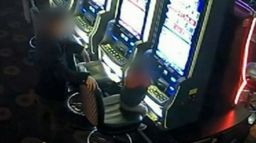 Club fined after shocking footage shows child playing pokies