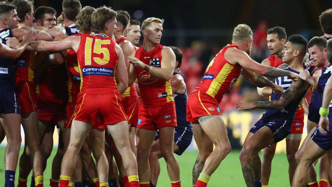 'You're all getting fined!': Massive melee spills over sidelines in Dockers, Suns clash