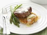 Steak with mustard sauce and potato cakes