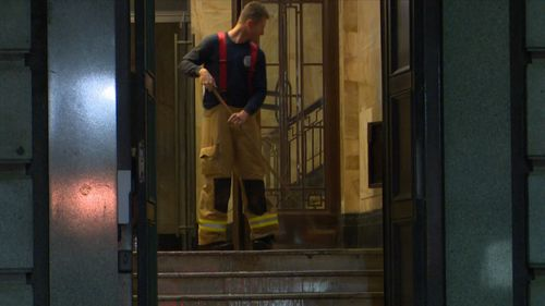 A Sydney CBD bank was flooded overnight after a fire hose was left on inside the building. Picture: 9NEWS.