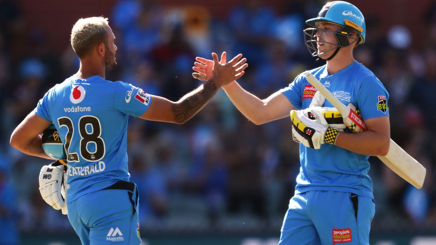 Jake Weatherald (L) and Phil Salt (R) of the Strikers celebrate victory