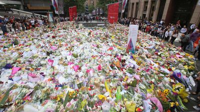 An aerial shot shows the sheer number of floral tributes left in Martin Place.