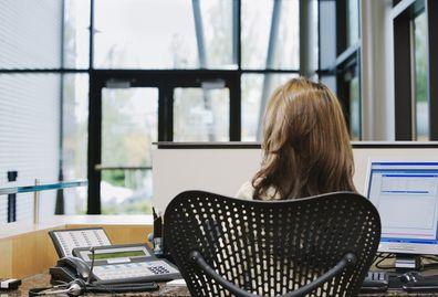 Receptionist sitting at desk