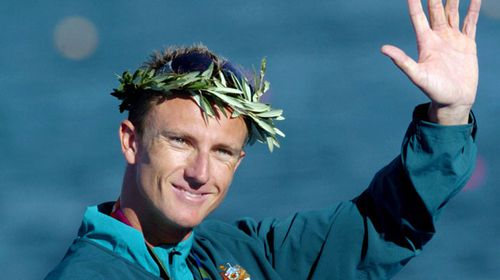 An August 28, 2004 file photo of Australian Nathan Baggaley celebrating after receiving a silver medal in the K1 500 mens event at the 2004 Olympic Games in Athens. (AAP)