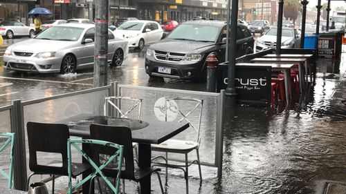 Sodden scenes on Bay Street, in Port Melbourne. (Melanie Larkin)