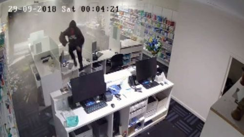 The thief was seen jumping over debris to steal boxes of medication.