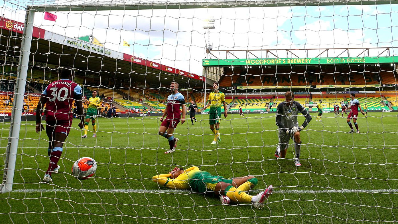 Burnley draw ends Liverpool's perfect home record in EPL, while Norwich relegated