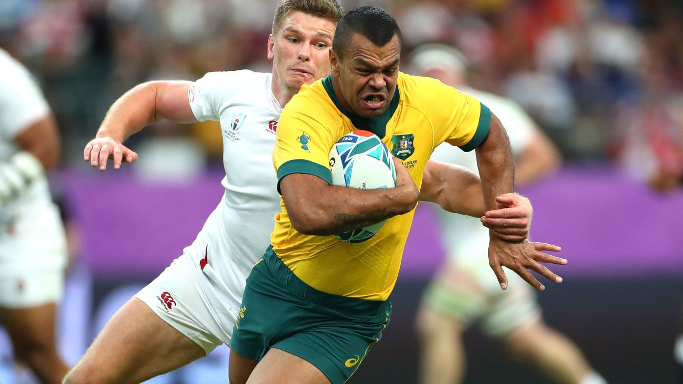 Kurtley Beale of Australia evades Owen Farrell of England
