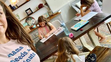 This photo provided by Amber Cessac shows Amber Cessac taking a selfie as her daughters do their homework at their home in Georgetown, Texas.