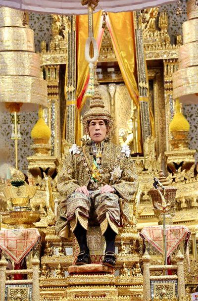 Thailand's King Maha Vajiralongkorn sits on the throne in front of an audience of diplomats and dignitaries after being officially crowned king at the Grand Palace, over the weekend.