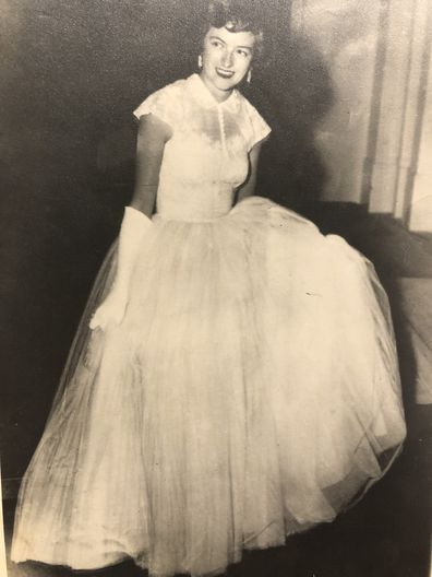 Rosalind Carrodus attending the royal banquet in her wedding gown, 1954.