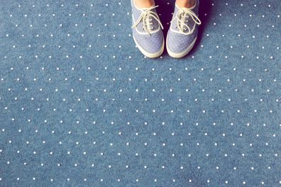 woman wearing blue shoes on carpet