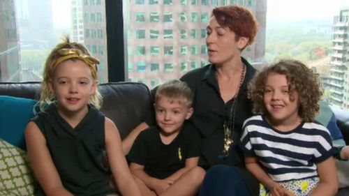 Michelle Coleman and her three children live in the Eureka Tower. (9NEWS)