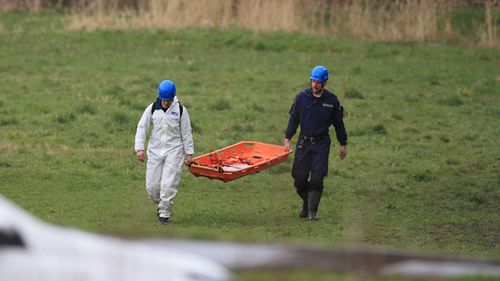 Police at the scene in a field near George Street in Heywood, Greater Manchester, after the body of a newborn baby was found. (AAP)