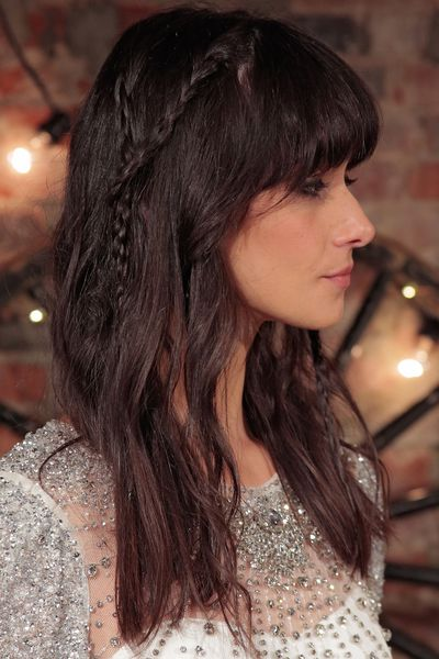 Another take on tousled hair at Jenny Packham saw hair random sections of hair plaited together to form a Y shape.