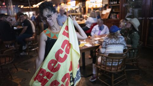Recall proponent, Roxanne Hoge held up a recall Gavin Newsom flag at an election party in Los Angeles.