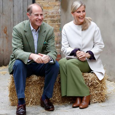 Prince Edward, Earl of Wessex and Sophie, Countess of Wessex sit on a hay bale during a visit to Vauxhall City Farm on October 1, 2020 in London, England. Their Royal Highnesses visit is to see the farm's community engagement and education programmes in action, as the farm marks the start of Black History Month