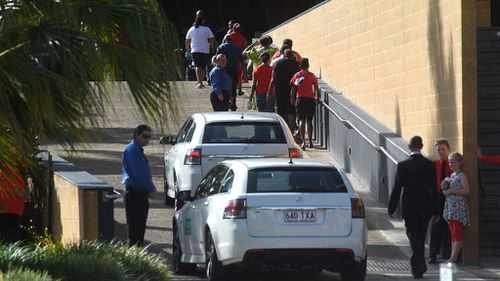 Hearses arrive at a memorial service for eight children at the Cairns Convention Centre. (AAP)