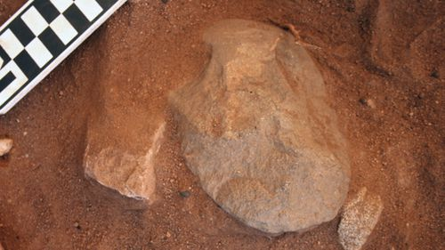 An edge-ground hatched head found at the Madjedbebe rock shelter in the Kakadu National Park in the Northern Territory which is part of new proof showing Aboriginal people lived in Australia up to 18,000 years earlier than once thought  (AAP Image/Gundjeihmi Aboriginal Corporation, Chris Clarkson).