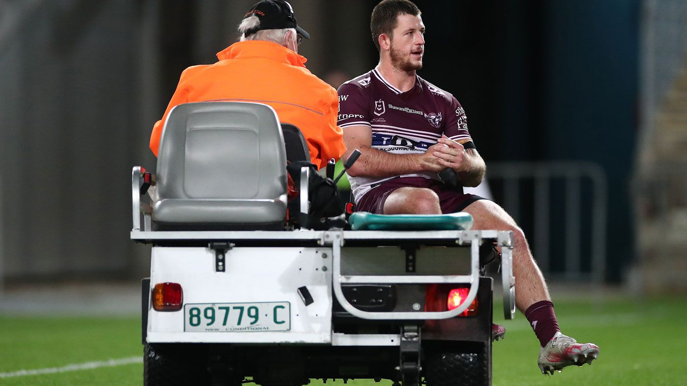 Cade Cust is taken from the field injured in Manly's win over the Bulldogs. (Getty)