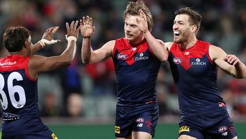Charlie Spargo of the Demons celebrates a goal with Kysaiah Pickett and Jack Viney during the 2021 AFL First Qualifying Final match between the Melbourne Demons and the Brisbane Lions at Adelaide Oval on August 28, 2021 in Adelaide, Australia. (Photo by Sarah Reed/AFL Photos via Getty Images)