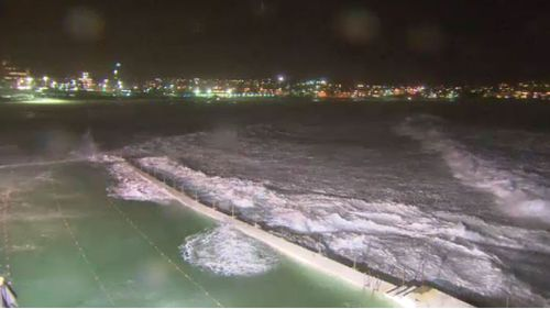 Waves crash over Bondi Icebergs pool. (9NEWS)