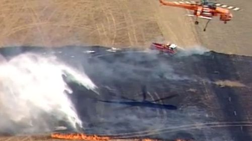 Firefighting aircraft are working to tackle the blaze.