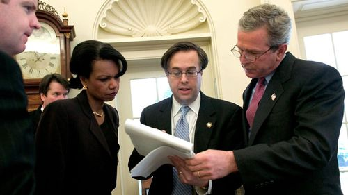 Brett Kavanaugh (second from left) was a powerful behind-the-scenes player in the Bush Administration. (AAP)