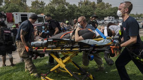 First responders attend to the injured protester.