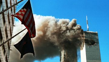 Dark, toxic smoke pours from the twin towers of the World Trade Center on September 11, after two hijacked planes hit each structure, later causing each to crash to the ground.