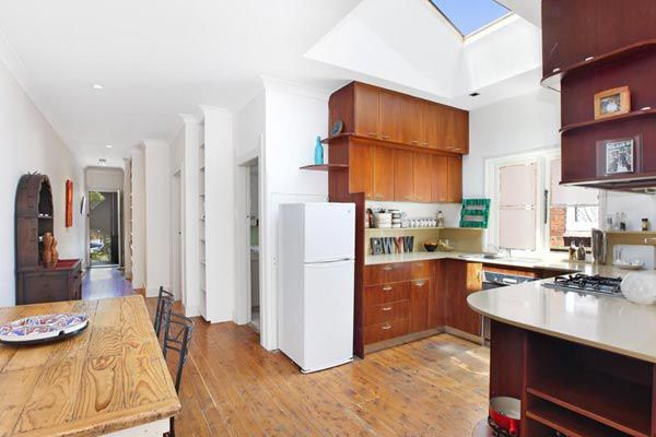 The Bondi apartment's kitchen is filled with the morning sun thanks to a skylight.
