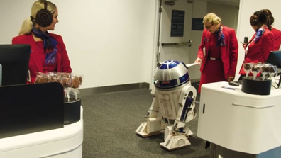 R2-D2 checks in on for the flight.