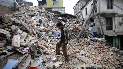 <p>The death toll from the Nepal earthquake has now exceeded 3600, as emergency services and aid workers battle to reach remote areas outside Kathmandu where they expect the toll will rise sharply.</p><p>  A man surveys the remains of a building in Kathmandu on Sunday, a day after the quake struck. (AAP) </p><p> Click through for images from the scene. </p><p></p>