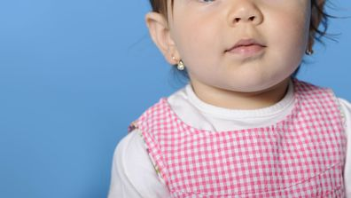 Shop slammed for its policy of physically restraining children to have their ears pierced