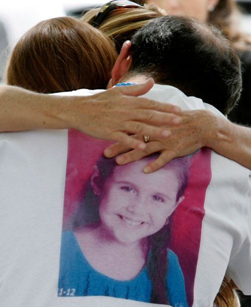 A file photo of Sergio Celis, wearing a shirt with a picture of his missing six-year-old daughter, Isabel.