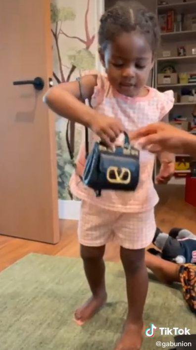 Gabrielle Union's daughter Kaavia receives designer bag.