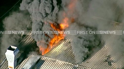 Firefighters battle to contain northern Sydney factory fire