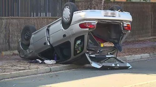 The overturned Subaru. (9NEWS)