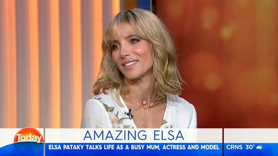Elsa Pataky brings the sass in sheer lace top and metallic mini for 'hometown' visit