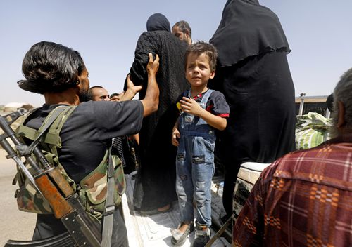 Displaced Syrians who fled from the Islamic State group's stronghold of Raqqa arrive in the village of Hawi al-Hawa, less than two kilometres west outside the city, on August 8, 2017. (AFP)