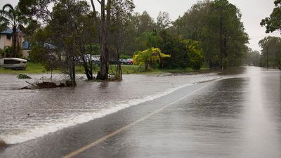 Most of the flood water in Deception Bay is running off roadways and onto surrounding properties. (Supplied: Olya Hilton)