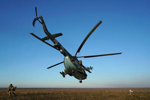 A Ukrainian military helicopter MI-8 takes off near Urzuf, south coast of Azov sea, eastern Ukraine.