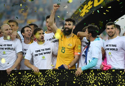 The Australia players celebrate winning the 2018 FIFA World Cup Intercontinental play-off football match. (AAP)